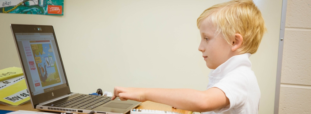 boy using laptop